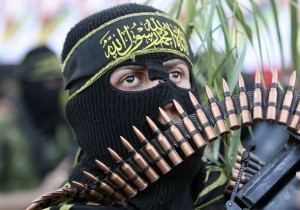 An Islamic Jihad militant takes part during an anti-Israel rally in Gaza