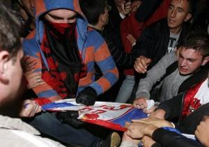 Demonstrators tear the Serbian flag in Tirana