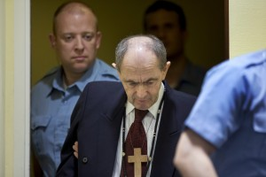 Tolimir is escorted by U.N. security guards as he arrives in the courtroom of the the Yugoslav war crimes tribunal who delivered its judgment in his appeal case in The Hague